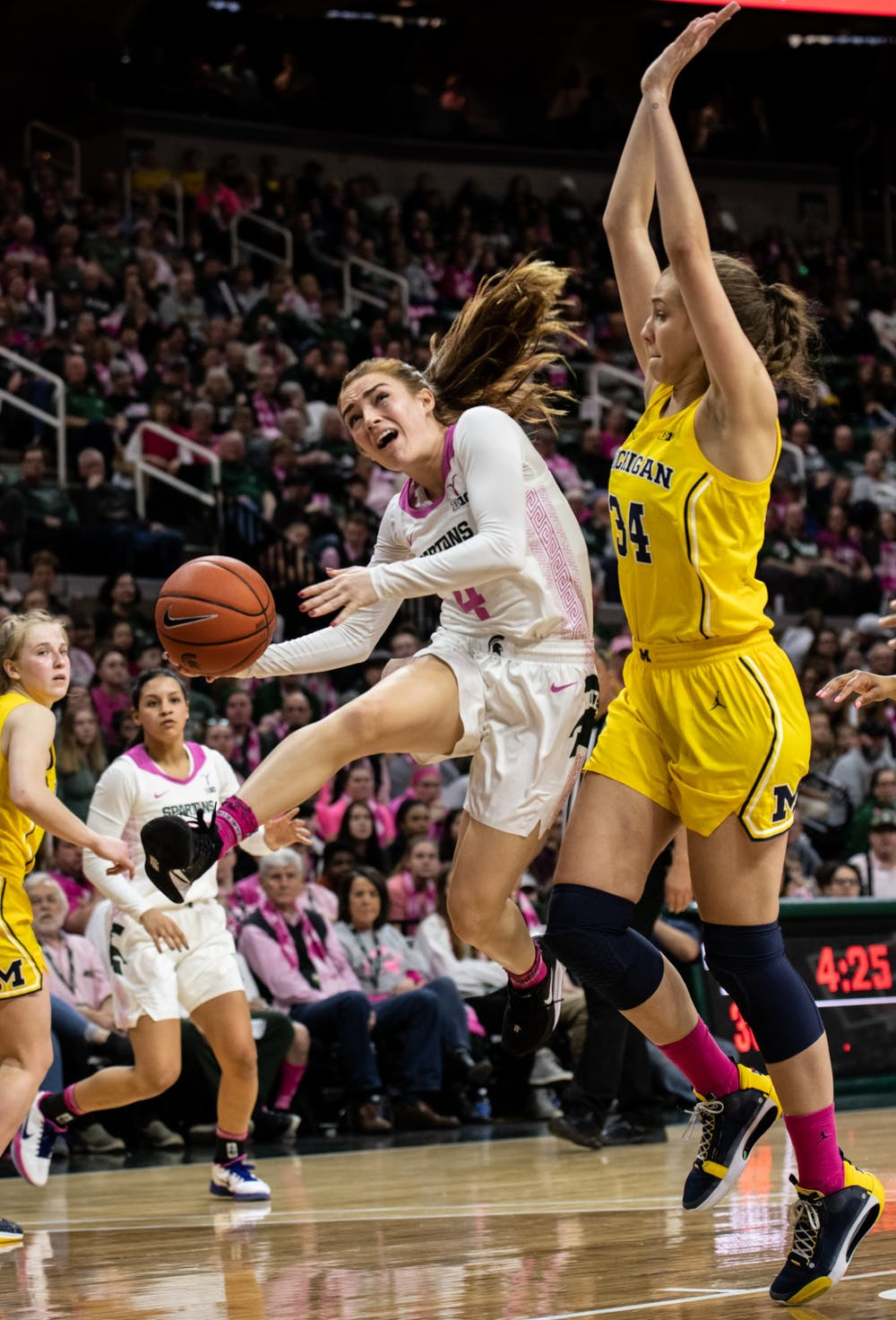 Senior guard Taryn McCutcheon (4) takes a shot during a basketball game against Michigan on Feb. 23, 2020.