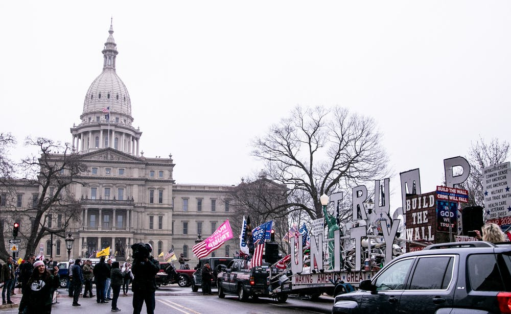 "A ""Trump Unity"" trailer drives up to the Capitol at the Operation Gridlock protest April 15, 2020 in Lansing."