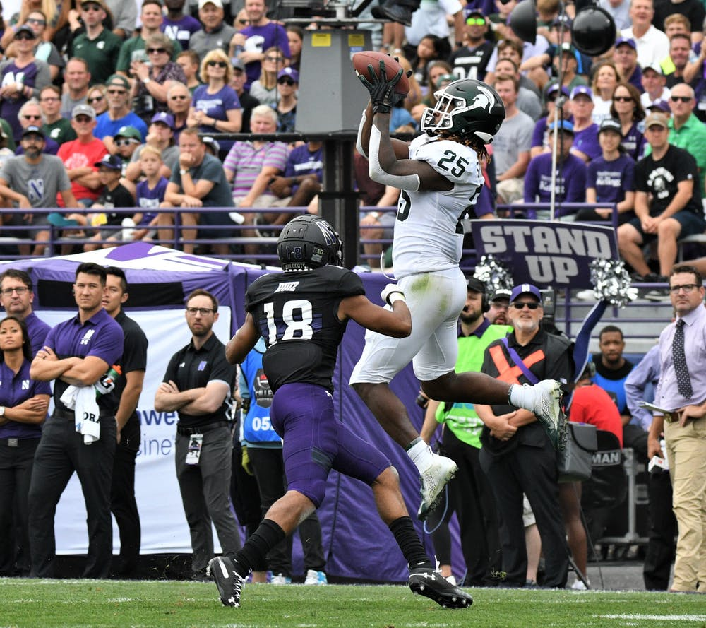 <p>Darrell Stewart Jr. (25) makes a catch during the game against Northwestern on Sept. 21, 2019 at Ryan Field. MSU defeated Northwestern, 31-10.</p>