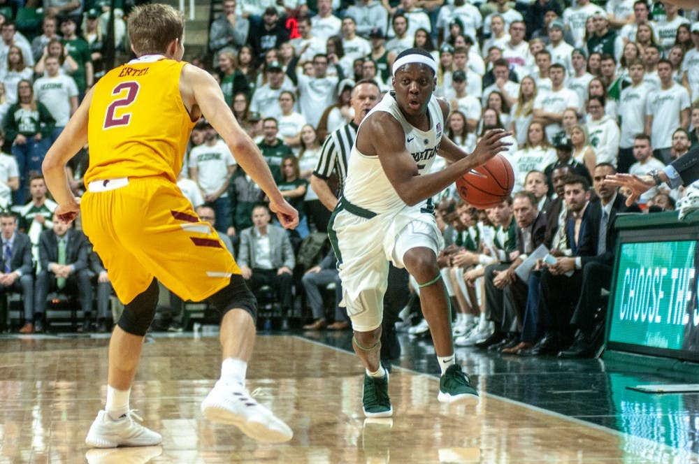 Junior guard Cassius Winston (5) moves down the court during the game against University of Louisiana-Monroe at Breslin Center on Nov. 14, 2018. The Spartans lead the Warhawks at halftime, 35-29.