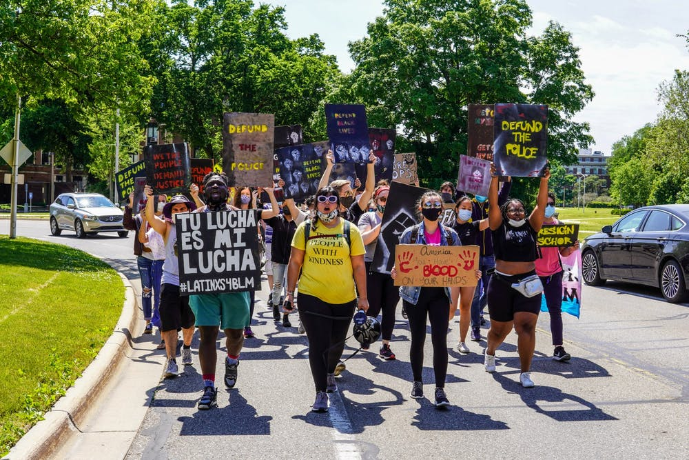 <p>Protesters march through Michigan State&#x27;s campus, during a protest in support of Black Lives Matter, in East Lansing, on June 12, 2020.</p>