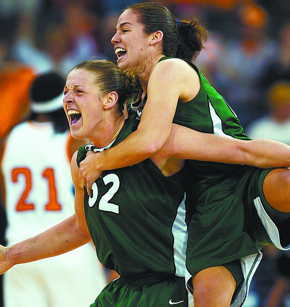 Michigan State's Liz Shimek (52) and Lindsay Bowen celebrate after beating Tennessee 68-64 in a national semifinal game at the NCAA Women's Final Four Sunday, April 3, 2005, in Indianapolis. (AP Photo/Ed Reinke)