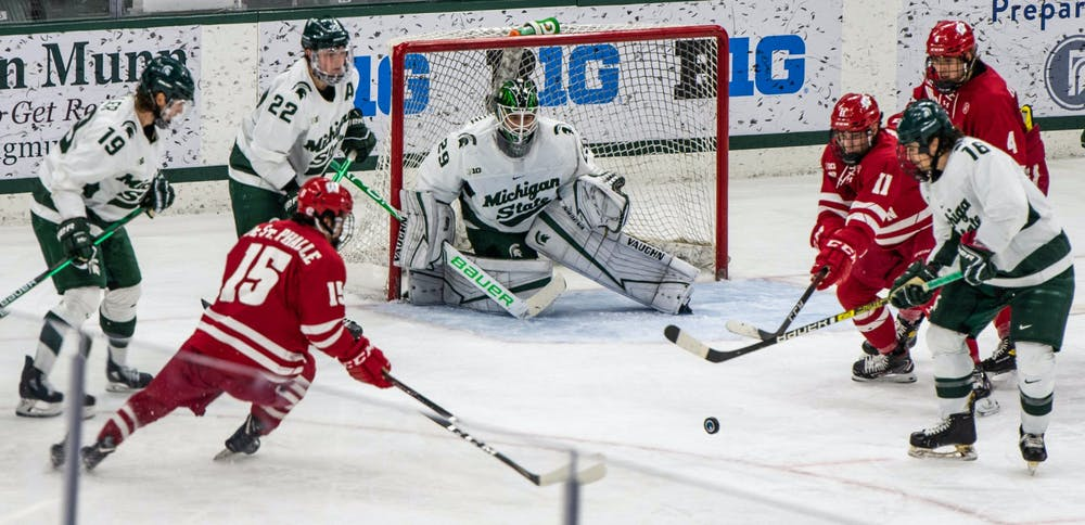 <p>Freshman goaltender Pierce Charleson (29) replaced DeRidder in the Michigan State goal early on in the game. The Badgers shut out the Spartans 4-0 at Munn Ice Arena on Mar. 5, 2021. </p>