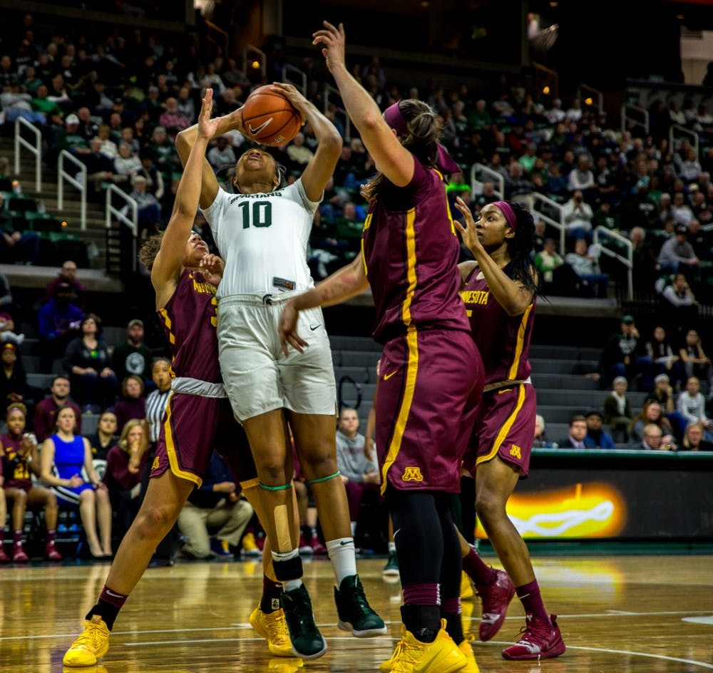 <p>Sophomore forward Sidney Cooks (10) fights to hold the ball during the first half of the game against Minnesota on Jan. 9, 2019 at Breslin Center. The Spartans lead the Gophers, 43-29 at halftime.</p>