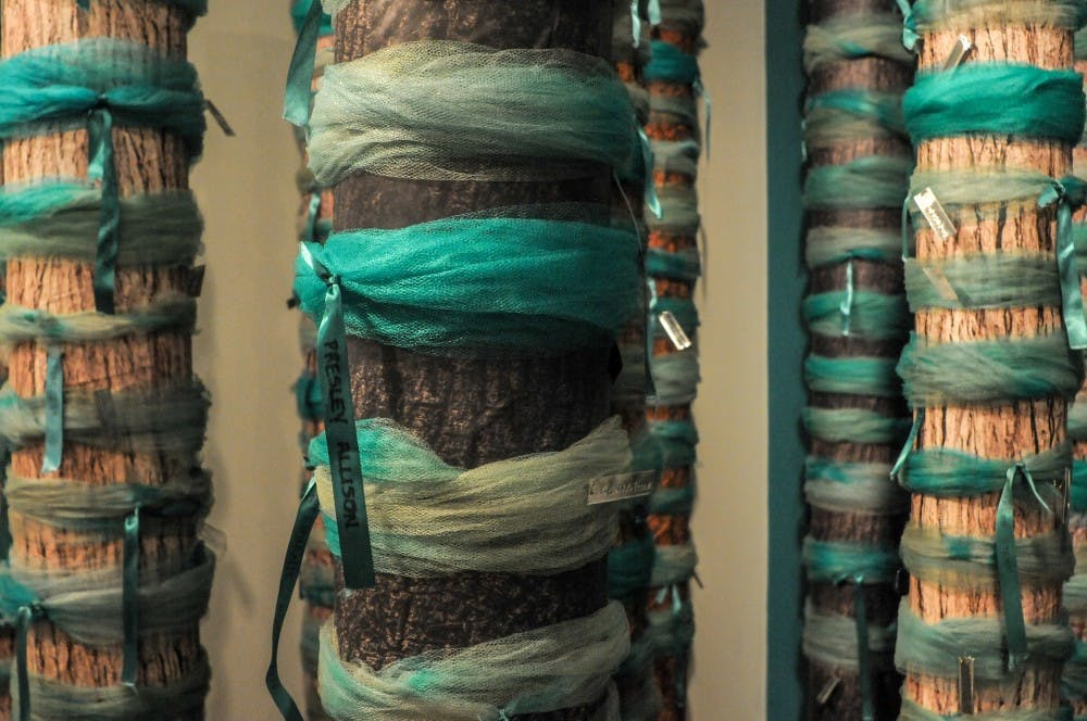 Ribbons are displayed during the Finding Our Voice: Sister Survivors Speak Exhibition Opening Ceremony at the MSU Museum on April 16, 2019.