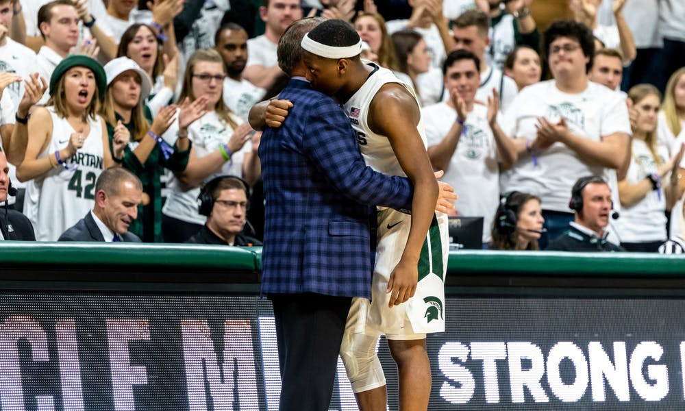 <p>Senior guard Cassius Winston (right) hugs coach Tom Izzo after being subbed out against Binghamton. The Spartans defeated the Bearcats 100-47 on Nov. 10, 2019 at the Breslin Student Events Center.</p>