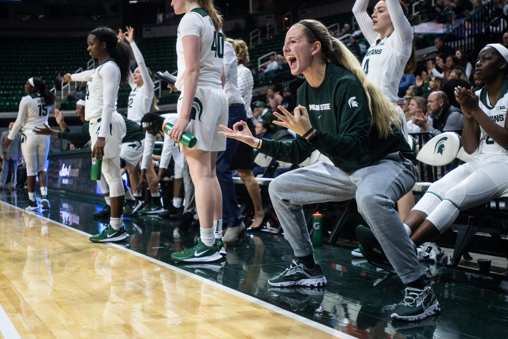 Redshirt sophomore Claire Hendrickson celebrates from the bench during the game against Eastern Michigan Nov. 5, 2019 at the Breslin Center.