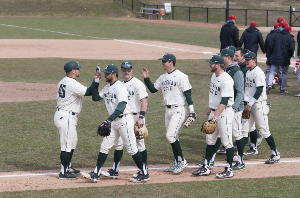 <p>&nbsp;Assistant head coach Graham Sikes (45) &nbsp;high fives his team after the game against the Rutgers on April 1, 2018 at McLane Baseball Stadium. The Scarlet Knights fell to Spartans, 6-0.&nbsp;</p>