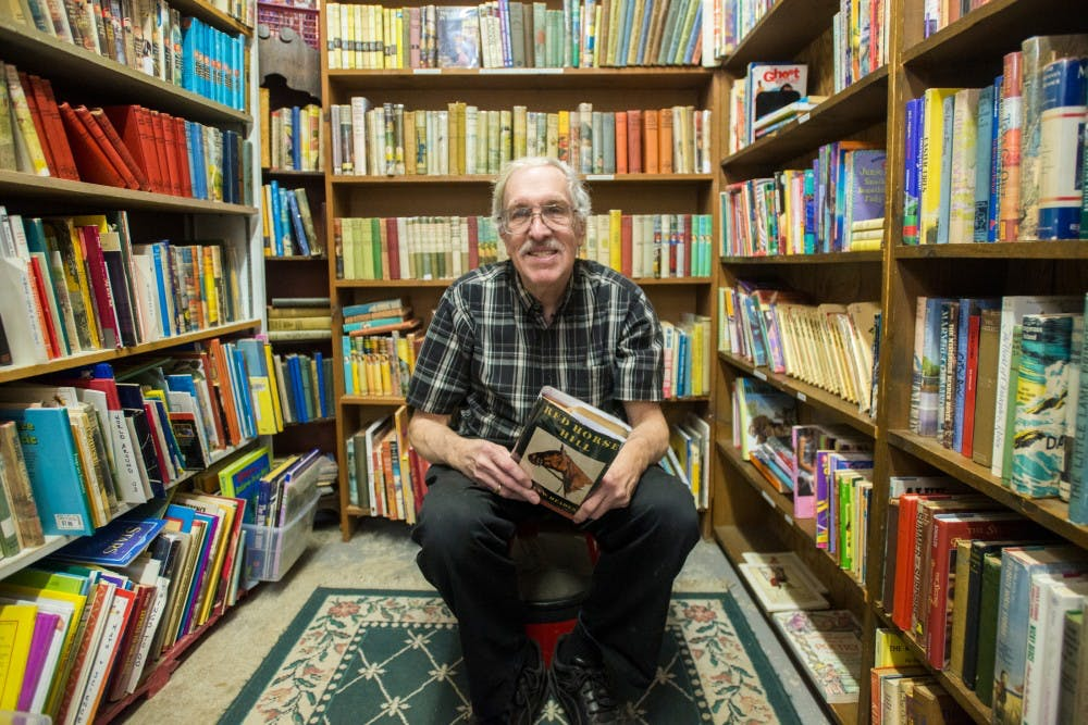 Lansing resident Ray Walsh poses for a portrait on Feb. 20, 2017 at Curious Book Shop at 307 E. Grand River Ave in East Lansing. Walsh is the owner of the Curious Book Shop which has been in its location for more than forty years.
