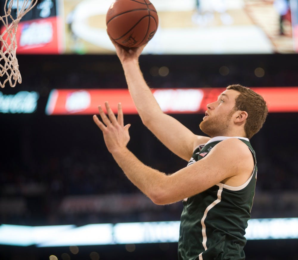 Junior forward Matt Costello attempts a basket April 4, 2015, during the semi-final game of the NCAA Tournament in the Final Four round at Lucas Oil Stadium in Indianapolis, Indiana. The Spartans were defeated by the Blue Devils, 81-61. Erin Hampton/The State News