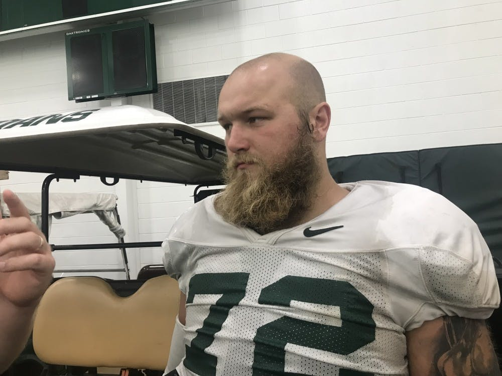 Senior defensive tackle Mike Panasiuk speaks to the press after a practice on Aug. 28, 2019.