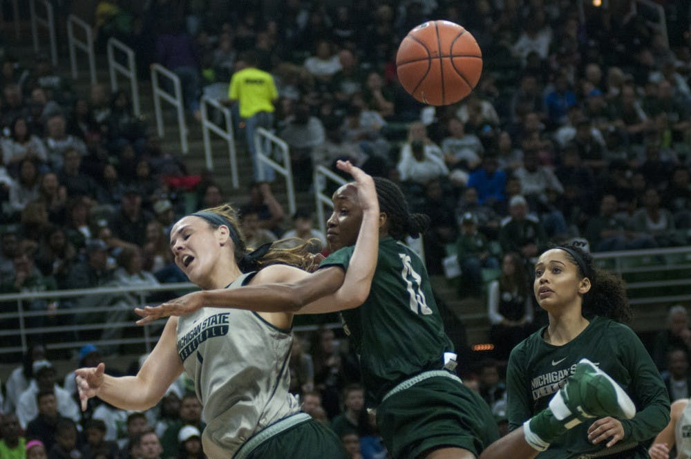 Senior guard Tori Jankoska (1) goes for a layup but is disrupted by junior guard Morgan Green (13) during Michigan State Madness on Oct. 14, 2016 at Breslin Center.