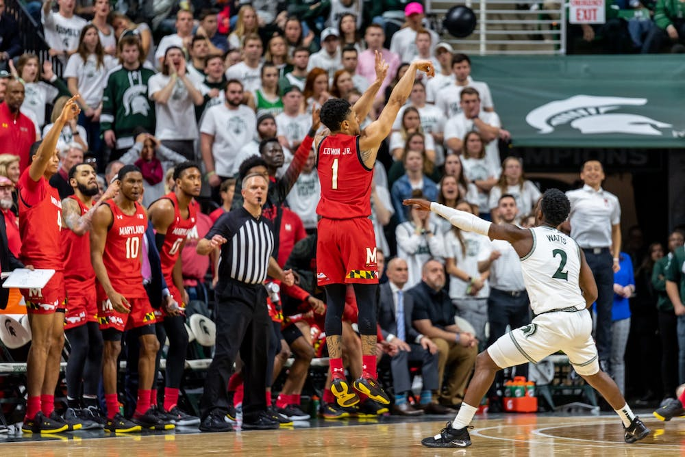 <p>Maryland's Anthony Cowan Jr. (1) shoots a three pointer over freshman guard Rocket Watts (2). The Spartans fell to the Terrapins, 60-67, on Feb. 15, 2020 at the Breslin Student Events Center.</p>