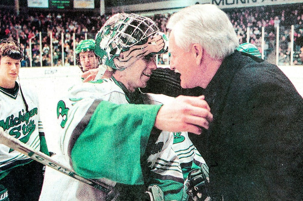 <p>Ryan Miller and Ron Mason, 2001. State News File Photo</p>