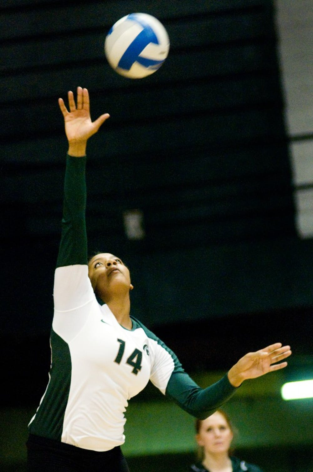 Freshman middle blocker Jazmine White makes a serve Saturday night at Jenison Field House. The Spartans defeated the Wildcats, 3-2. Justin Wan/The State News
