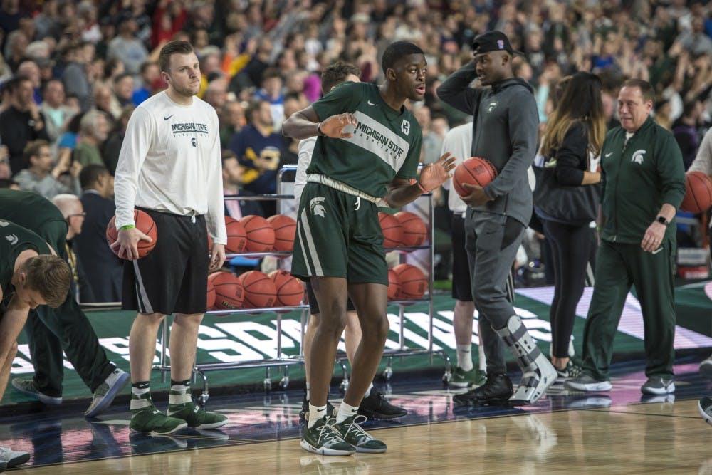Freshman forward Gabe Brown (13) dances during Michigan State's NCAA Men's Basketball Final Four open practice at U.S. Bank Stadium in Minneapolis on April 5, 2019. (Nic Antaya/The State News)