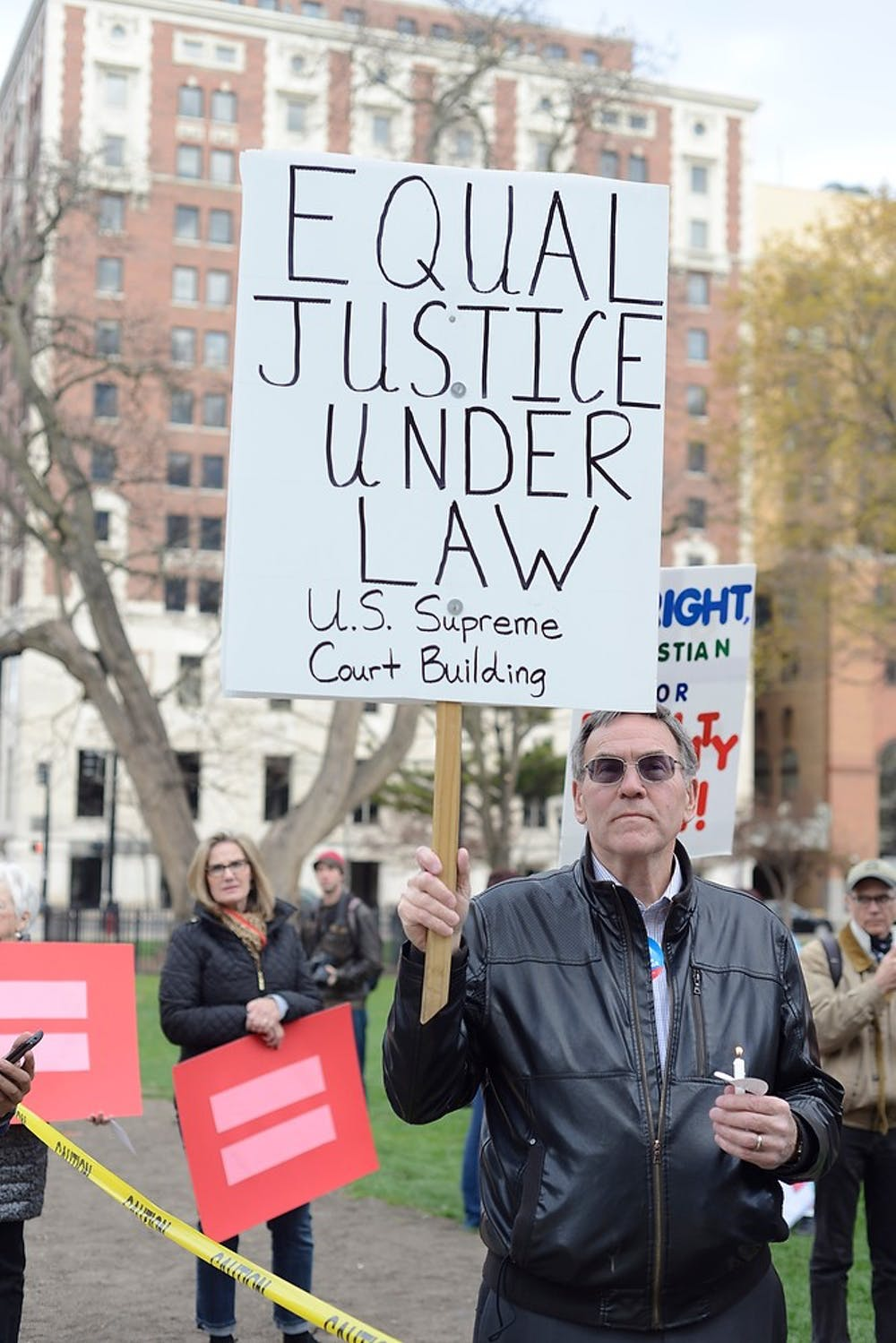 <p>Kalamazoo resident Lorence Wenke stands to support same-sex marriage April 27, 2015, at the Lansing Capit0l. The vigil was held in anticipation of the same-sex marriage trials in the U.S. Supreme Court. Hannah Levy/The State News</p>