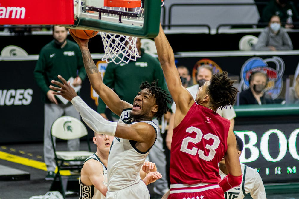 <p>Junior guard Aaron Henry shoots a contested layup on March 2, 2021. Henry had an all-around performance with 22 points, eight rebounds and five assists in the Spartan victory against the Hoosiers.</p>