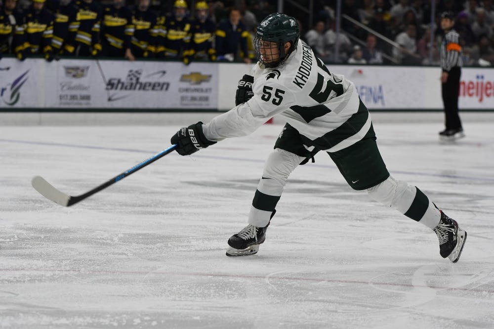 <p>Senior forward Patrick Khodorenko (55) follows through his slap shot during the game against Michigan on Feb. 14, 2020 at the Munn Ice Arena. MSU fell to U of M, 5-1.</p>