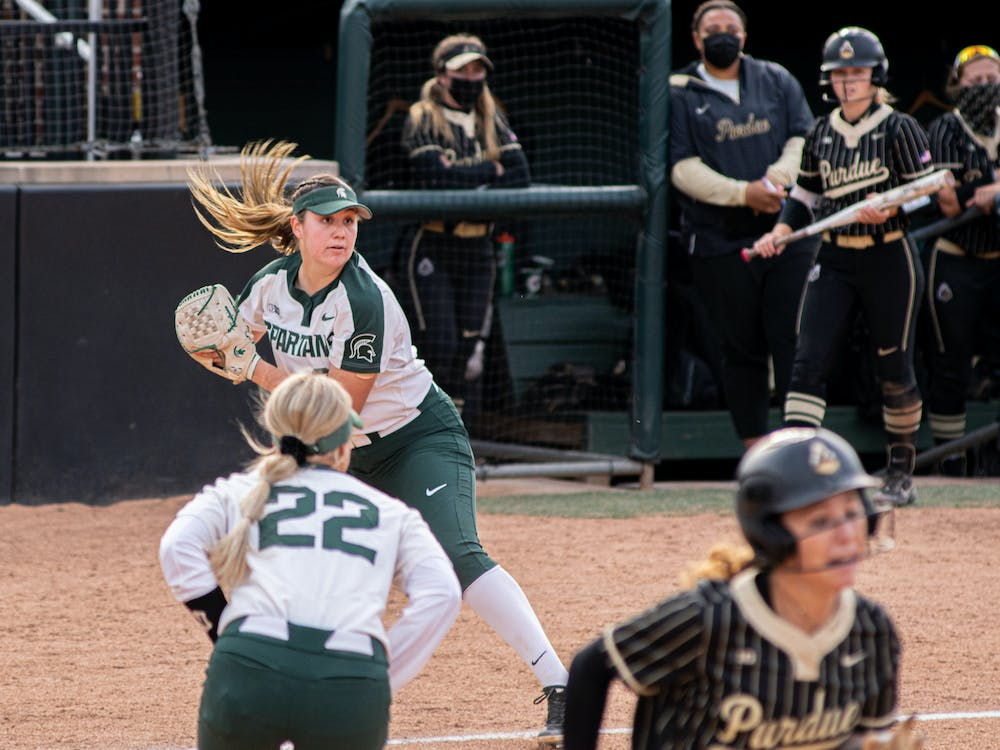 Michigan State freshman Alexis Barroso looks to throw to first and secure a double-play, after catching a pop-up near home on April 23, 2021. The Spartans fell to Purdue 8-7.