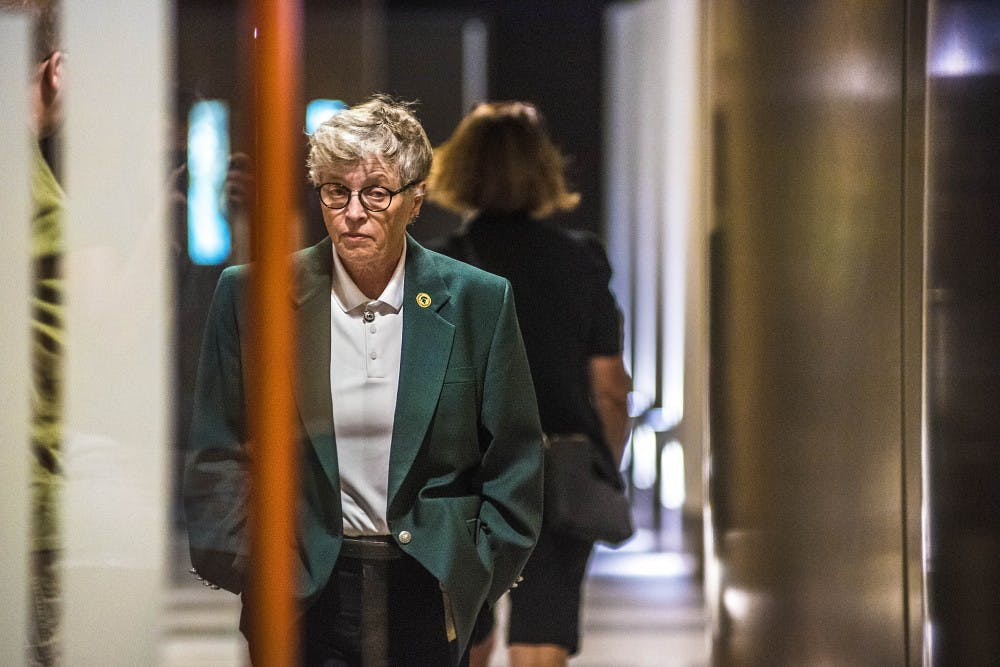 <p>Former MSU President Lou Anna K. Simon walks into the Red Cedar Room before a press conference on Sept. 23, 2017 at the Kellogg Center.&nbsp;</p>