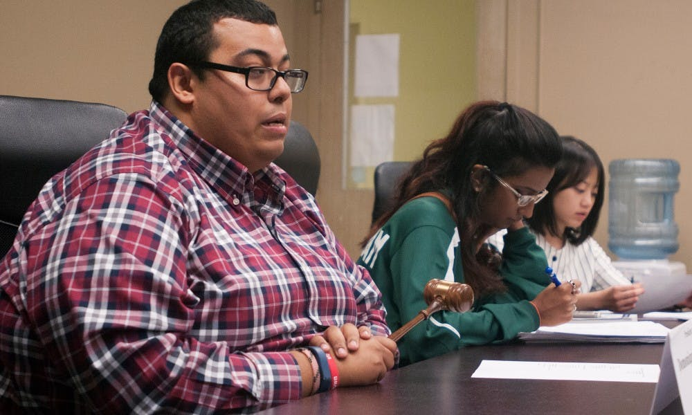 <p>Public policy senior Domonique Clemons, president of the associated students, addresses the policy committee at the ASMSU meeting on Sept. 24, 2015 in the Student Affairs and Services building. He said that he hopes to use the skills gained during his time at ASMSU to work in local or state government in Michigan.</p>