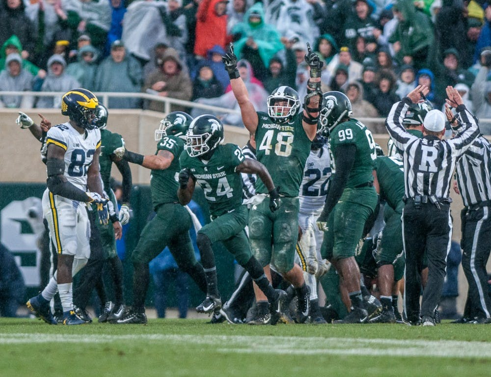 The Spartans celebrate after recovering a fumble during the game against Michigan on Oct. 20, 2018 at Spartan Stadium. The Spartans lost to the Wolverines 21-7.