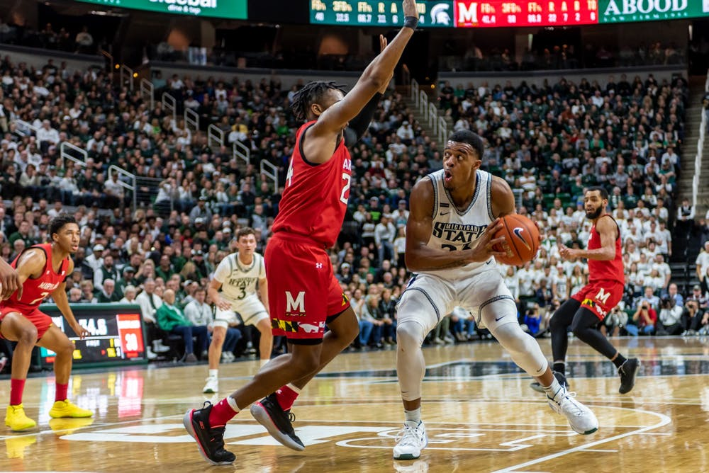 <p>Junior forward Xavier Tillman (right) is defended by Maryland's Donta Scott (left). The Spartans fell to the Terrapins, 60-67, at the Breslin Student Events Center on Feb. 15, 2020. </p>