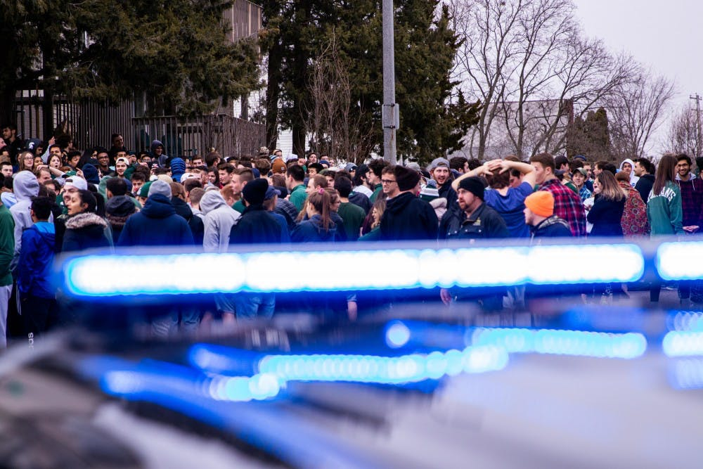 Fans celebrate MSU's victory over Duke in the Elite Eight in Cedar Village Apartments March 31, 2019.