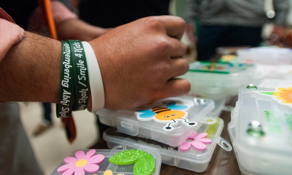 A remembrance bracelet for Abhi Shah is pictured during the Smile 4 Kids meeting on Oct. 11, 2017 at Natural Science. The Smile 4 Kids club will focus on having events to fundraise for kids and tutoring.