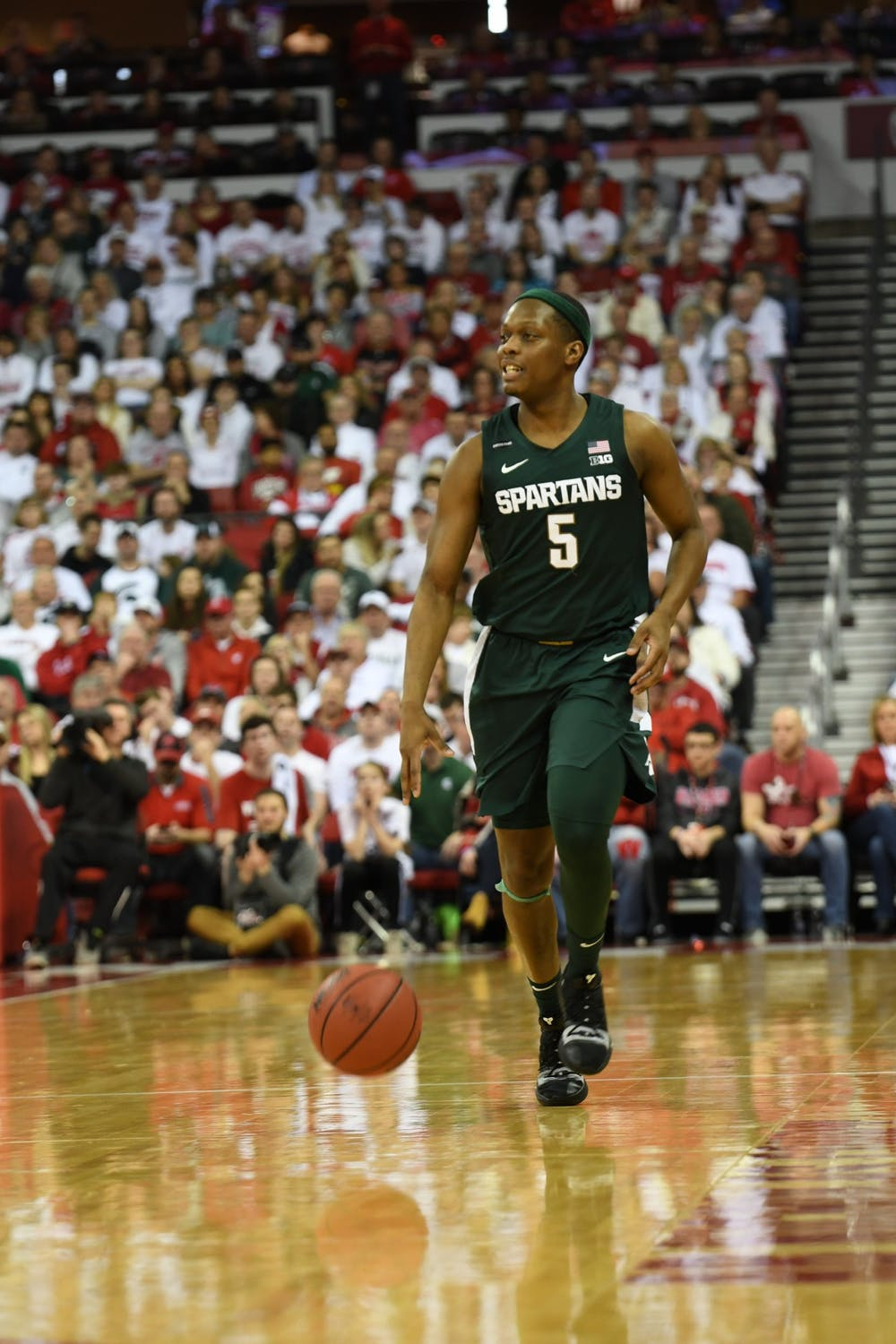 Senior guard Cassius Winston (5) dribbles down the court during the basketball game against Wisconsin at the Kohl Center in Madison, Wisconsin on February 1, 2020. The Spartans fell to the Badgers 63-64.