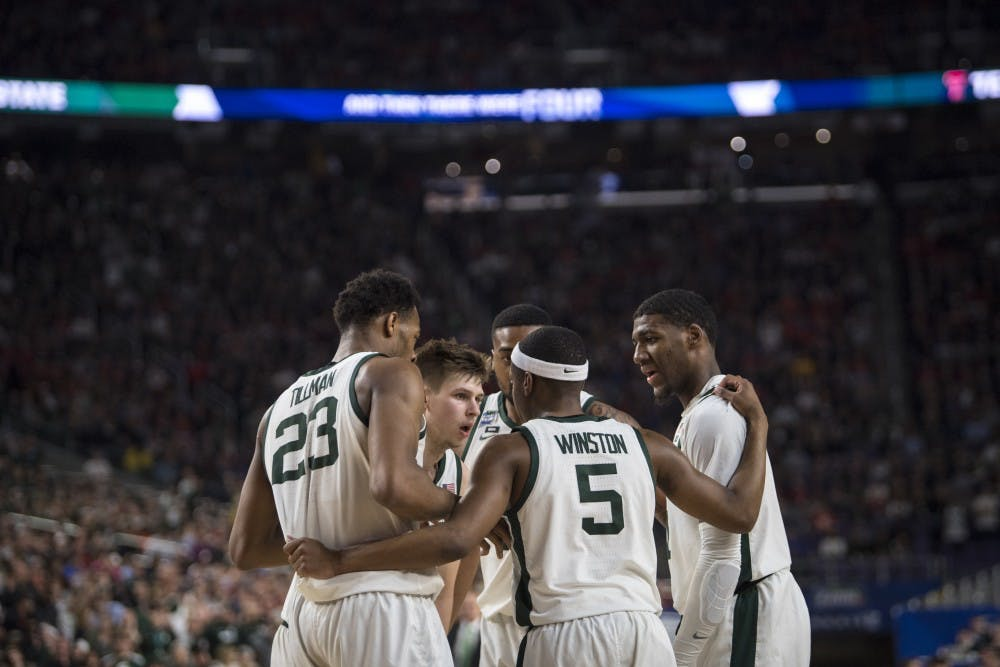 The Spartans huddle during the first half of the NCAA Final Four game against Texas Tech at U.S. Bank Stadium in Minneapolis on April 6, 2019. (Nic Antaya/The State News)