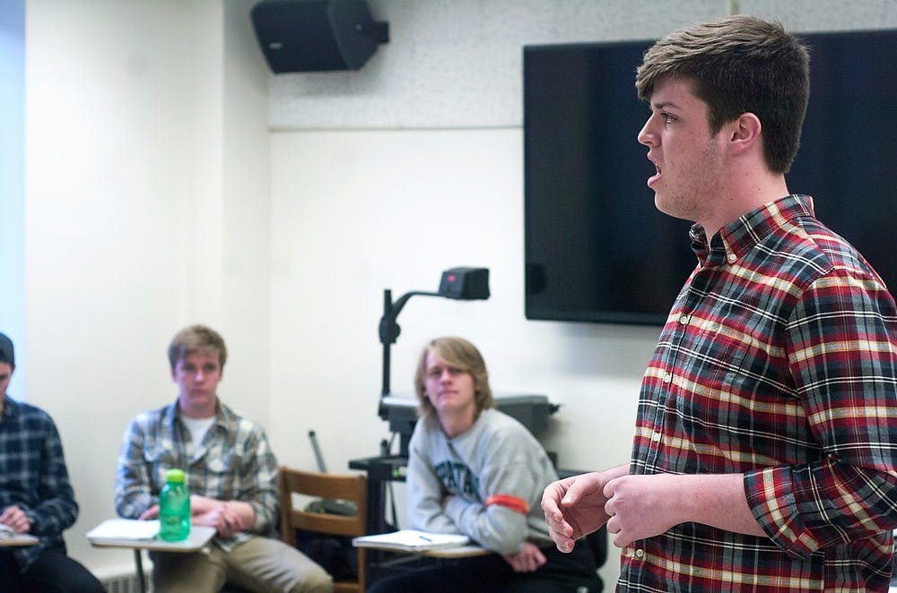 "<p>Actuarial science freshman Patrick Flanagan auditions for the A Capella group, Capital Green on April 15, 2014, at Music Practice Building. Flanagan performed ""Bridge Over Troubled Water"" by Simon and Garfunkel for his audition. Meagan Beck/The State News</p>"