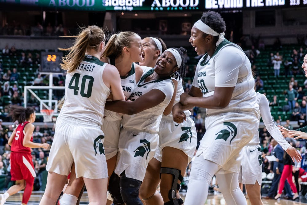 The MSU women's basketball team celebrates coming back against Nebraska. The Spartans defeated the Cornhuskers, 78-70, at the Breslin Student Events Center on December 31, 2019.