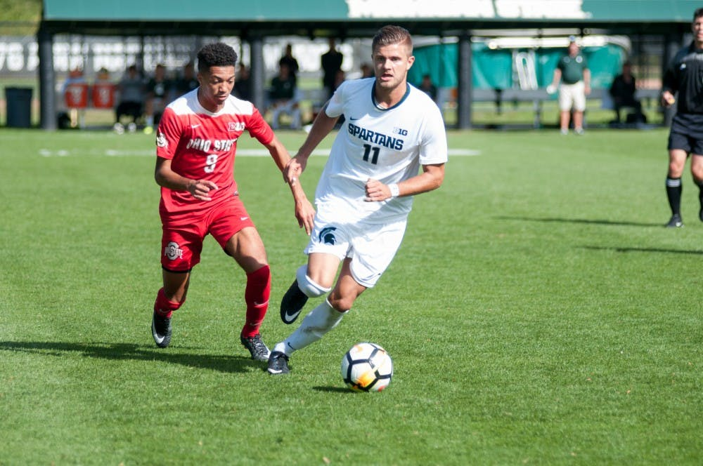 Junior forward Ryan Sierakowski runs away from a defender during the game against Ohio State, on Oct. 1, at DeMartin Stadium at Old College Field. The Spartans defeated the Buckeyes, 5-1.