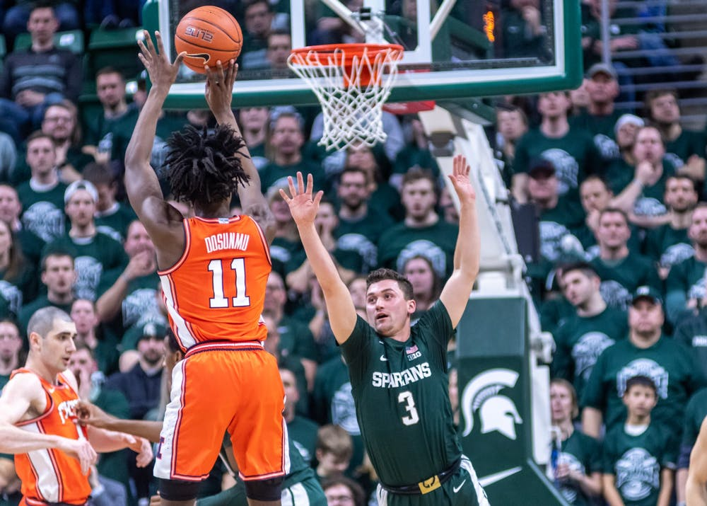 Illinois guard Ayo Dosunmu (11) shoots over sophomore guard Foster Loyer (3). The Spartans defeated the Illini, 76-56, at the Breslin Student Events Center on January 2, 2020.