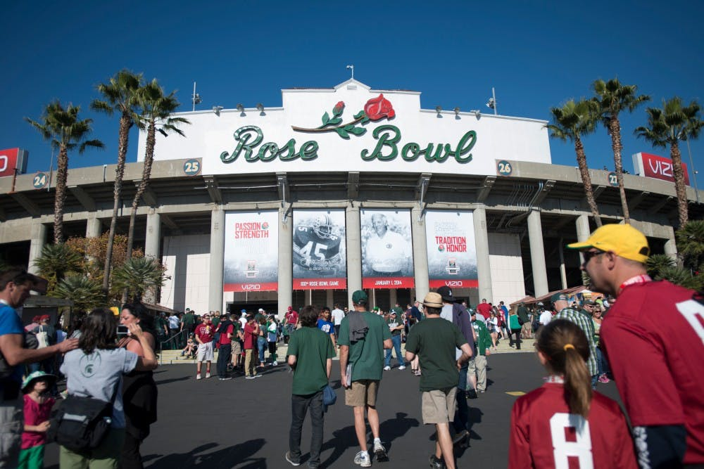 """<p>Attendees enter the Rose Bowl for the <span class=""""caps"""">MSU</span> vs. Stanford game Jan. 1, 2014, in Pasadena, Calif. The Spartans claimed Rose Bowl victory. Julia Nagy/The State News</p>"""