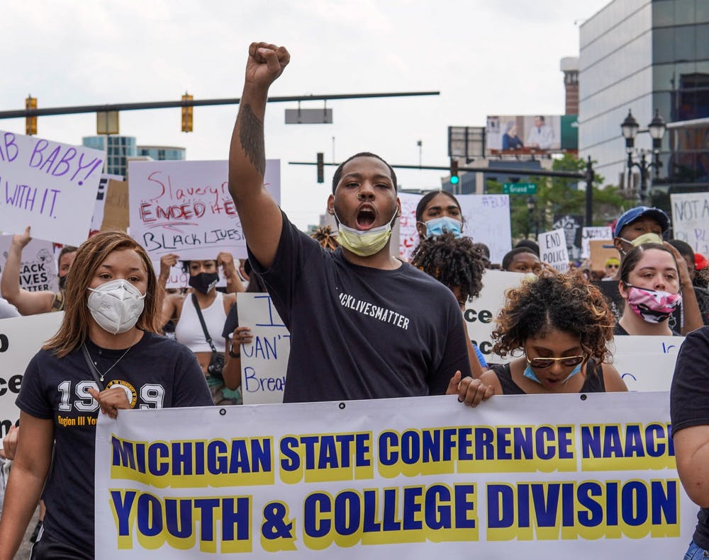 <p>Protesters begin marching during the &quot;We Are Done Dying&quot; protest held by the Michigan NAACP Youth and College Division at the Michigan State Capitol on June 10, 2020.</p>