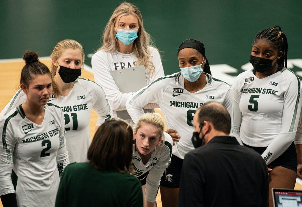 Michigan State volleyball coach Cathy George talks to her team during a timeout against Ohio State on Jan. 31, 2021. The Spartans dropped the home game at Jenison Field House in three sets.