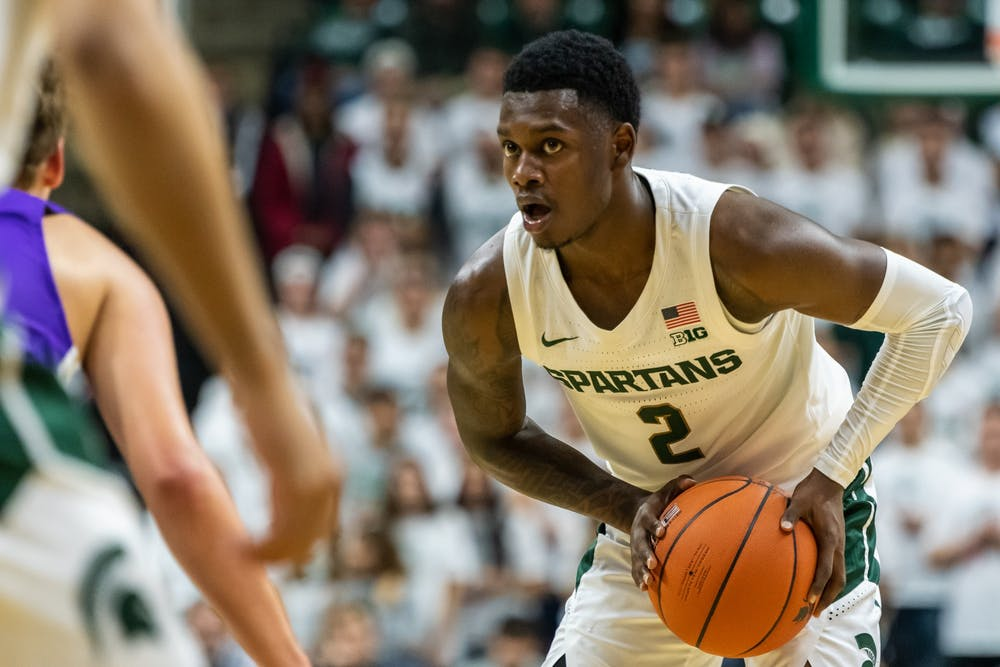 <p>Freshman guard Rocket Watts eyes up the Albion defense. The Spartans lead the Britons, 40-25, at half on Oct. 29, 2019 at the Breslin Student Events Center.</p>