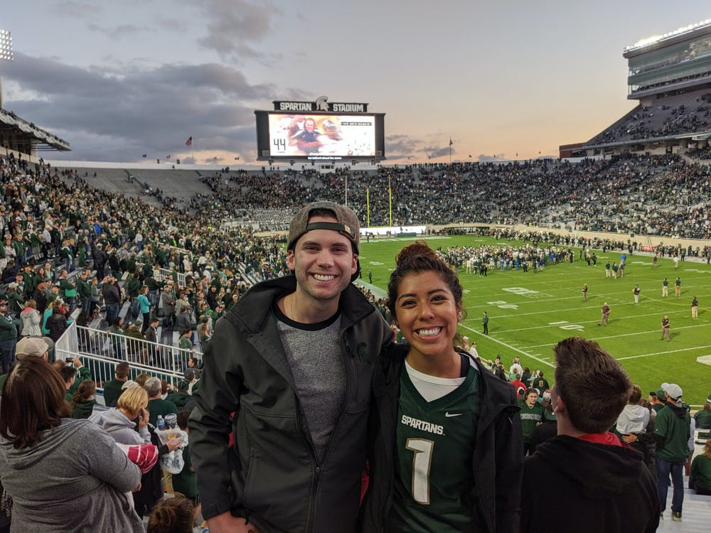 <p>MSU alumni Adam Brandt and Jess Hernandez at Spartan Stadium. </p>