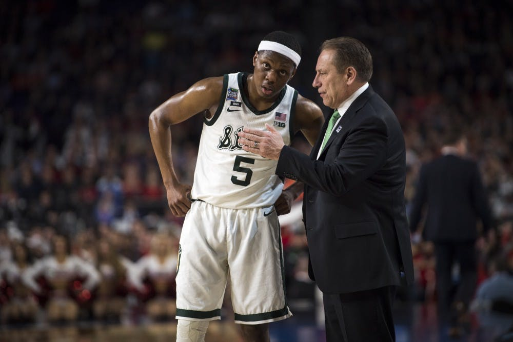 Junior guard Cassius Winston (5) talks with Michigan State head coach Tom Izzo during the second half of the NCAA Final Four game against Texas Tech at U.S. Bank Stadium in Minneapolis on April 6, 2019. The Spartans lost to the Red Raiders 61-51.  (Nic Antaya/The State News)
