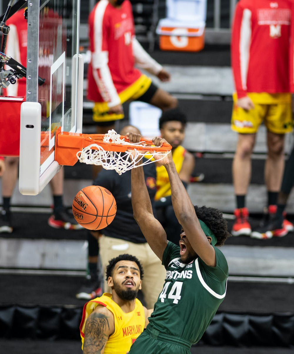 <p>MSU forward Gabe Brown (44) dunks in the Big Ten basketball tournament during the game against Maryland on March 11, 2020.</p>