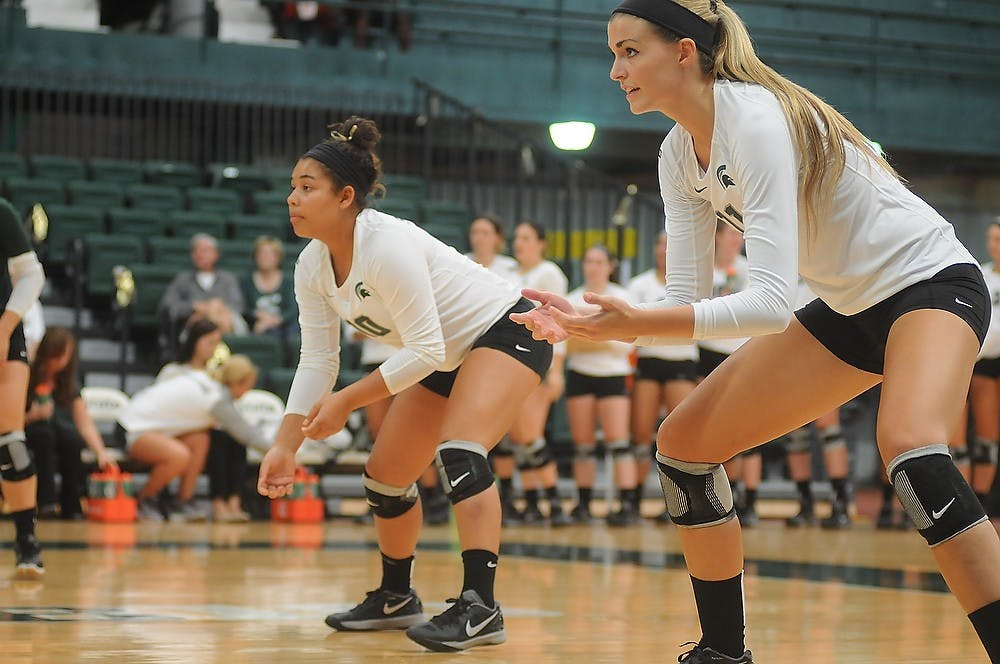 <p>Sophomore outside hitter Chloe Reinig prepares to hit the ball Sept. 6, 2014, at Jenison Fieldhouse during a game against Duke University. The Blue Devils defeated the Spartans, 3-2. Aerika Williams/The State News</p>