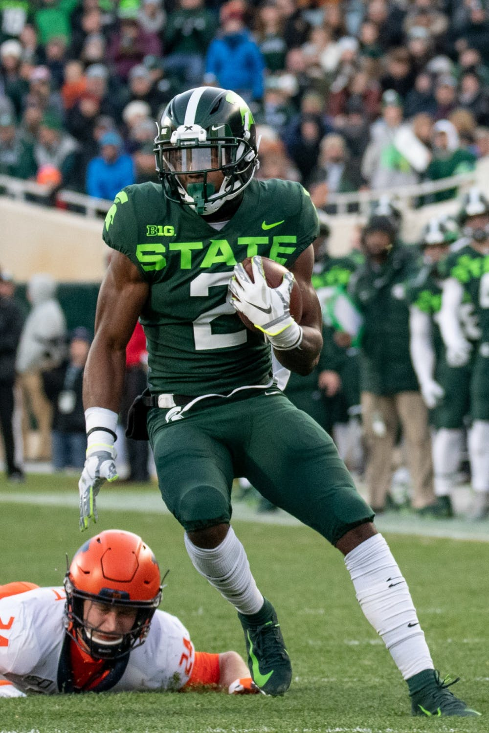 <p>Freshman wide receiver Julian Barnett (2) runs upfield during the game against Illinois on Nov. 9, 2019 at Spartan Stadium.</p>