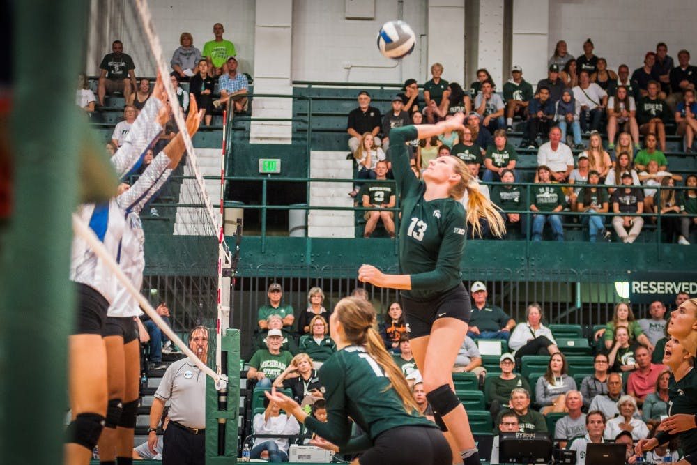 <p>Redshirt senior outside hitter Brooke Kranda (13) goes up for a kill during the game against Texas A&amp;M on Sep. 2, 2017, at Jenison Field House. The Spartans defeated the Islanders, 3-0.</p>