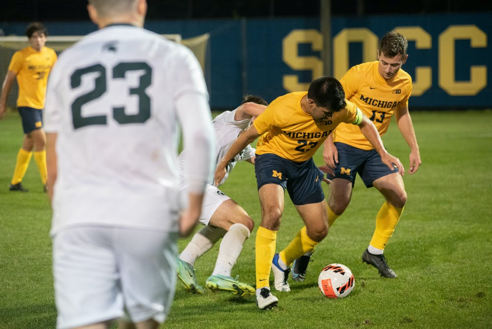 <p>Michigan State attempts to stop University of Michigan&#x27;s fifth-year midfielder Marc Ybarra from getting the ball in the tied game on Oct. 5, 2021.</p>