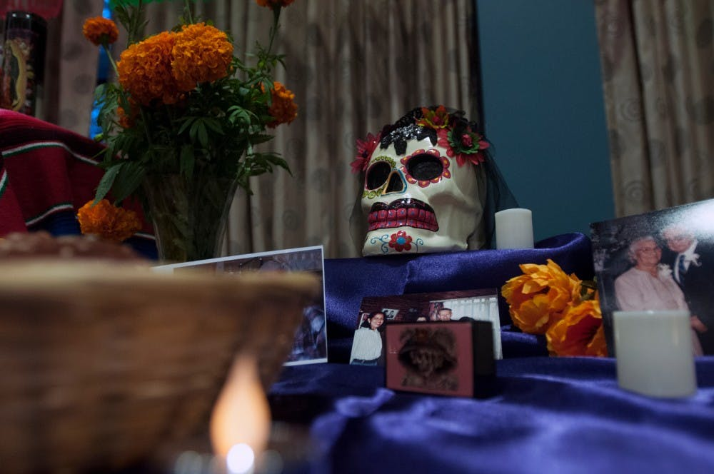 An ofrenda is on display during a Dia de los Muertos event on Nov. 2, 2016 in the Erickson Hall Kiva. Ofrendas are collections of objects placed on a ritual altar to honor and remember the dead.