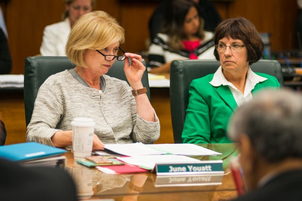 <p>Provost June Youatt and Trustee Dianne Byrum listen to a statement from president Lou Anna K. Simon during the Board of Trustees meeting on June 6, 2017, at the Hannah Administration Building. The board discussed tuition, budget and facility renovations.</p>