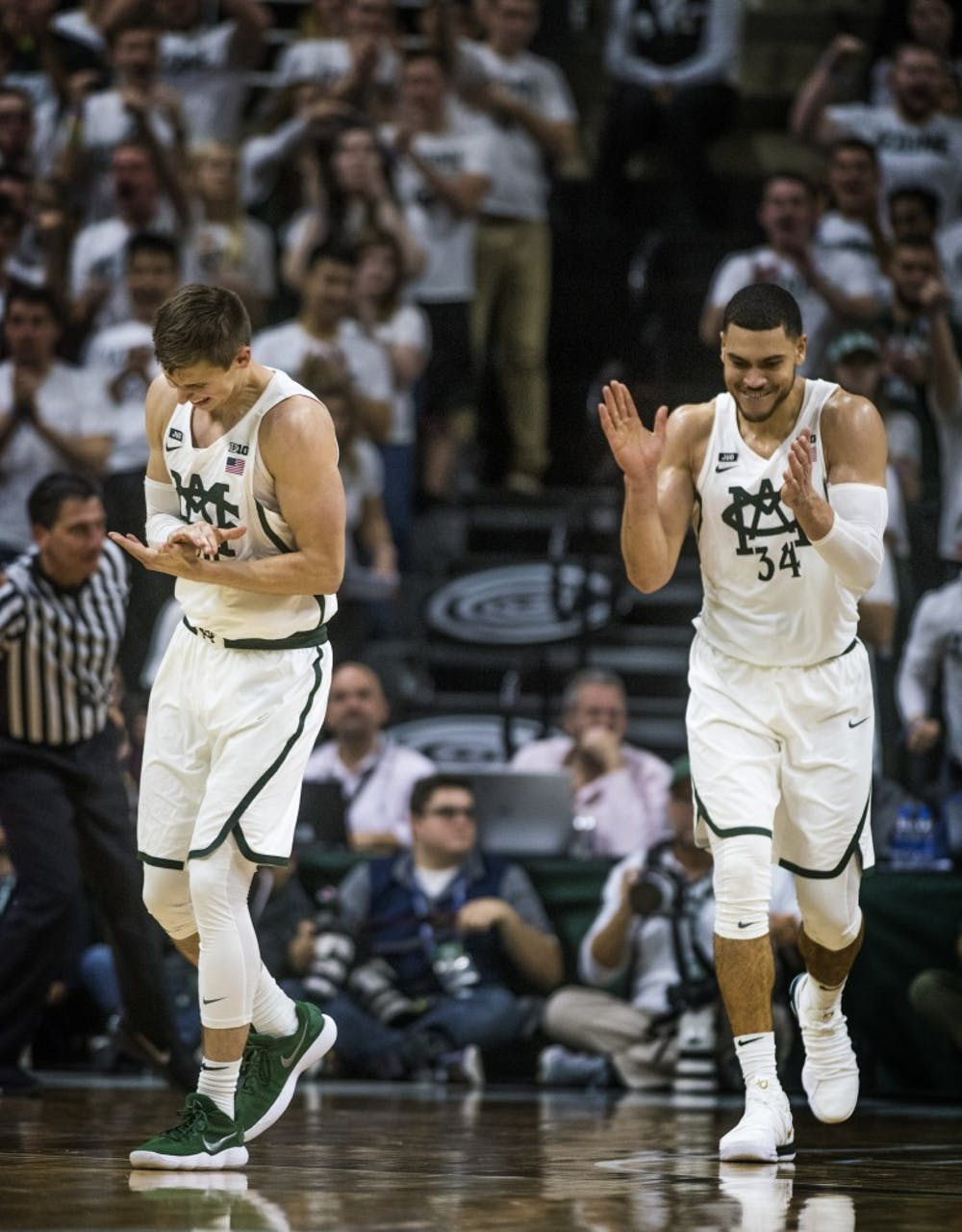 Junior guard Matt McQuaid (20), left, and redshirt senior Gavin Schilling (34) react to a play during the game against Notre Dame on Nov. 30, 2017 at Breslin Center. The Spartans took down the Fighting Irish, 81-63.